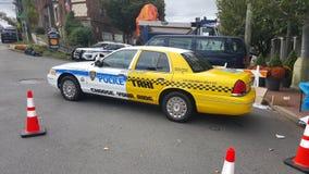 Hybride de voiture de police de taxi Photographie stock libre de droits