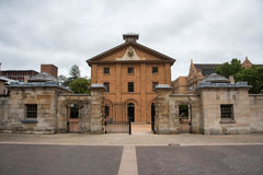 Hyde Park Barracks Museum. SYDNEY,NSW,AUSTRALIA-NOVEMBER 19,2016: Hyde Park Barracks Museum with boundary wall and open gate in the Queen`s Square in Sydney Stock Photo