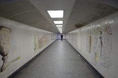 Hyde Park Corner: pedestrian underpassage. Solitary pedetsrian using the pedestrian underpassage in Hyde Park, London. The walls are decorated with ceramic Stock Photography