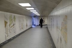Hyde Park Corner: pedestrian underpassage. Solitary pedetsrian using the pedestrian underpassage in Hyde Park, London. The walls are decorated with ceramic Royalty Free Stock Images