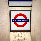 Hyde Park Corner tube station signage and roundel. LONDON, UK - 5 OCTOBER 2017: The traditional London Underground roundel shaped sign which incorporates the Royalty Free Stock Images