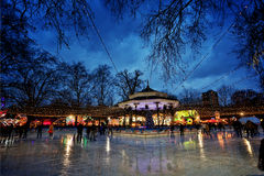 Hyde Park ice rink. London, United Kingdom - December 9, 2012: People ice skating at the Winter Wonderland ice rink in Hyde Park Royalty Free Stock Photography