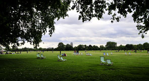 Hyde park in London. Deckchairs in Hyde park, London Royalty Free Stock Image