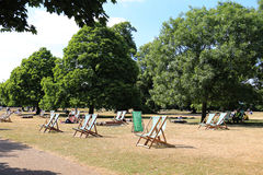 Hyde Park in London. One of the sunny day at Hyde Park in London with the rental deck chair Stock Images