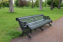 Hyde Park, London. London, United Kingdom - cast iron bench in famous Hyde Park Stock Image