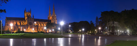 Hyde Park Night Pan. Sydney hyde park night panorama landmark St. Mary's cathedral and Archibald fountain beauty illuminated blue sky green trees Stock Photos
