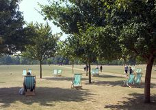 Hyde Park Relaxing. Deck Chairs in Hyde Park, London Royalty Free Stock Images