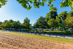 Hyde park in the summer. LONDON - JULY 19:  Hyde park is a famous London park. People are cycling on a hot day in the summer on July 19, 2016 in London Stock Photography