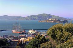 Hyde Street Pier and Alcatraz Island in San Francisco Bay, California. View of Hyde Street Pier and Alcatraz Prison in San Francisco Bay from Nob Hill, San stock photo