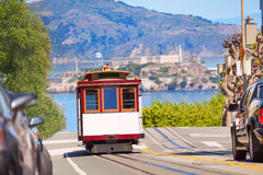 Hyde street and San Francisco tram during summer. Sunny day with Alcatraz island on background, San Francisco, USA Royalty Free Stock Images