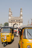 Auto Taxis at Hyderabad's Charminar. HYDERABAD, ANDHRA PRADESH, INDIA - JANUARY 10: Auto taxis waiting for passengers by the landmark Charminar tower on January Royalty Free Stock Image