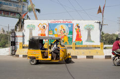 Hyderabad Temple sign. HYDERABAD, ANDHRA PRADESH, INDIA - JANUARY 12: An auto taxi passes the entrance sign for a Hindu Temple in central Hyderabad on January 12 Royalty Free Stock Photo
