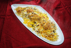 Hyderabadi Chicken Biryani. This Biryani is prepared with marinated raw chicken with mild spices and half cooked Basmati rice together. Then cooked on dum royalty free stock image