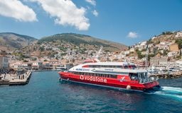 Ferry arriving at Greek island Hydra. Hydra, Greece - May 30, 2009: Hydra is a Greek island in the Aegean sea belonging to the Saronic islands. Motor vehicles Royalty Free Stock Photo