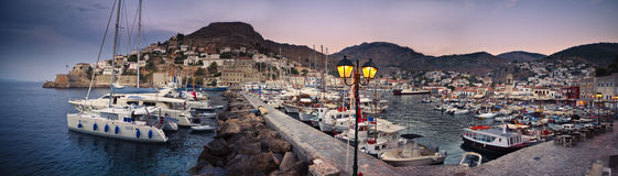 Hydra harbor in Greece. Hydra harbor at dusk in Greece royalty free stock photos