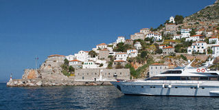 Hydra island with yacht in the foreground Royalty Free Stock Images