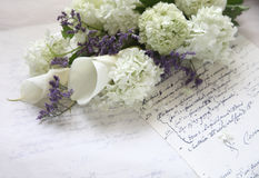 Hydrangea flower bouquet on old script Royalty Free Stock Images