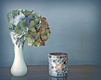 Hydrangea flower in vase and candle Royalty Free Stock Photography