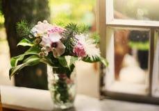 Hydrangea flowers bouquet in mug vase close up photo. On windowsill Stock Images