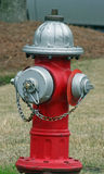 Hydrant. Silver and red fire hydrant Royalty Free Stock Photography
