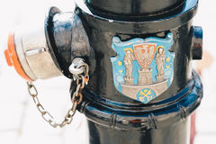 Hydrant with the coat of arms of Poznań. Old fire hydrant with the coat of arms of Poznań; Poland - shallow depth of field Royalty Free Stock Photos