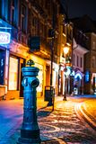 Hydrant on a colorful, illuminated street in a historic style royalty free stock image