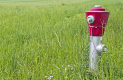 Hydrant with red head Royalty Free Stock Photo