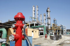 Hydrant in a refinery. Red hydrant in a petrochemical oil refinery royalty free stock photos