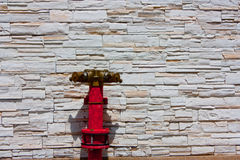 Hydrant beside wall 1. Beautiful wall tobe protect from fire Stock Image