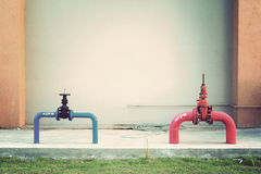 Hydrant with water hoses and fire extinguish. Equipment Royalty Free Stock Images