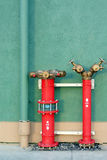 Hydrant with water hoses and fire extinguish. Equipment Stock Photos