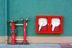 Hydrant with water hoses and fire extinguish. Equipment Stock Photo
