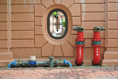 Hydrant with water hoses and fire extinguish Royalty Free Stock Photo