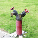 Hydrant with water hoses and fire extinguish equipment Royalty Free Stock Images
