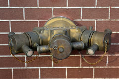 Hydrant with water hoses and fire extinguish equipment Royalty Free Stock Photo