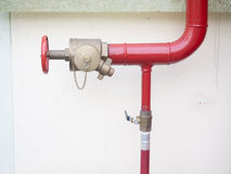 Hydrant with water hoses and fire extinguish equipment Stock Photo