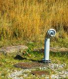 Hydrant water pipe near the road Stock Image