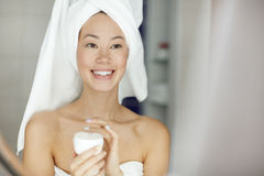Hydrating skin. Young woman taking care of her sensitive skin Stock Image