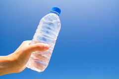 Hydration. Hand holding a water bottle. An image of hydration Royalty Free Stock Photos