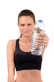 Hydration is important. Girl holding a bottle of water offering you to drink. Royalty Free Stock Photography