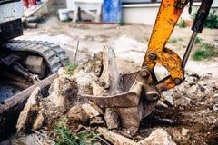 Hydraulic backhoe bulldozer loading concrete blocks Royalty Free Stock Image