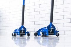 Hydraulic car floor jacks. Car Lift. Blue Hydraulic Floor Jack For car Repairing. Extra safety measures. Car service station. Hydraulic car floor jacks. Car stock photos