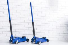 Hydraulic car floor jacks. Car Lift. Blue Hydraulic Floor Jack For car Repairing. Extra safety measures. Car service station royalty free stock photo
