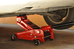 Hydraulic car jack. To lift car for change the wheel Stock Photos