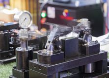 Hydraulic clamping jig. For machining process ; Blurred from moving component stock image