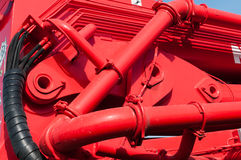Hydraulic connections. View on red hydraulic connectons and hoses Stock Photo