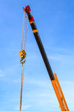 Hydraulic crane beams against blue sky Royalty Free Stock Photos