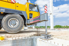 Hydraulic crane foot is supported for safety, Lateral stabilizer Stock Images