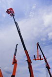 Hydraulic Cranes With Cherry Picker Basket Stock Image
