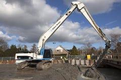 Hydraulic crawler crane digs Stock Photos